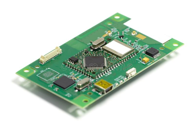 Electronic printed circuit board with chips and other components, front side, angled view, isolated on white stock images