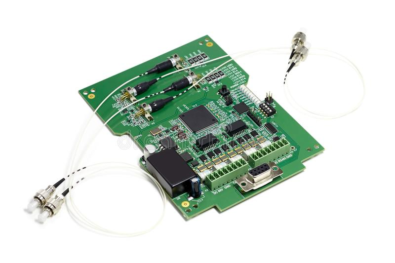 Electronic printed circuit board with microchip, many electrical components and optical connectors stock image