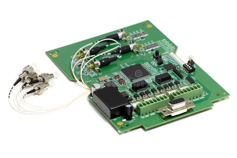 Electronic printed circuit board with optic connectors attached and other components, front side, angled view, isolated on white stock images