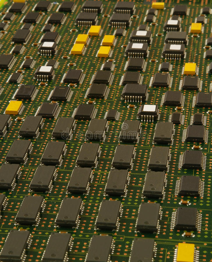Electronic printed circuit board. Printed circuit board with a variety of semiconductors, capacitors and resistors. Good background graphic image. All labeling stock image
