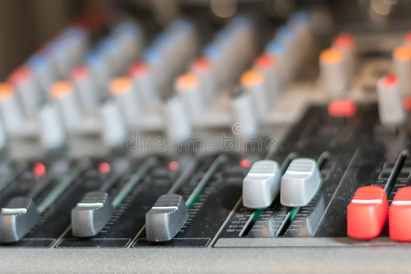 electronic professional sound mixer control panel in music studio with channel console stock images