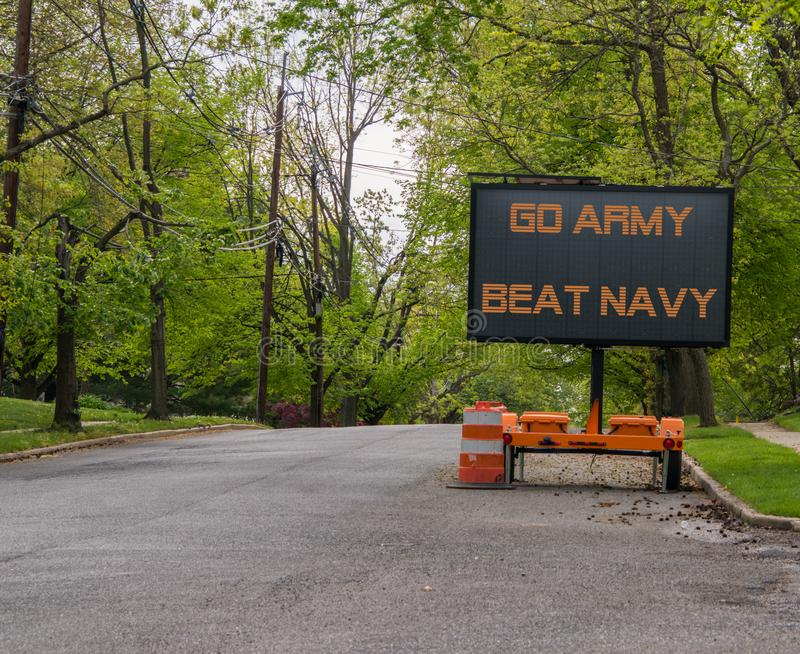 Electronic road sign on a suburban street that says Go Army Beat Navy. Electronic road sign on a suburban street that says Go Army Beat Navy stock images