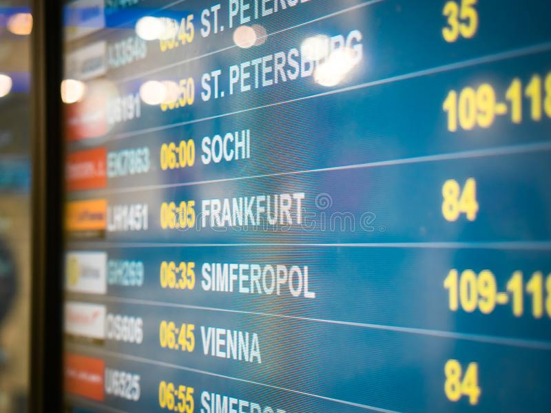 Electronic scoreboard flights and airlines. Destinations: Simferopol, Bahrain, Minsk, St.Petersburg, Sochi, Frankfurt royalty free stock image