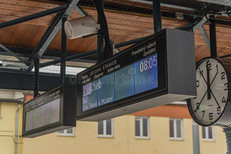Electronic signs in Plzen main station on platform in spring day. Electronic signs in Plzen main station on platform in spring cloudy day background blue bohemia royalty free stock photos