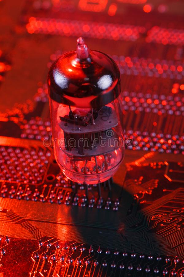 Electronic vacuum tube on circuit board. Electronic vacuum tube on printed circuit board stock image