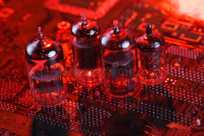 Electronic vacuum tube on circuit board. Electronic vacuum tube on printed circuit board royalty free stock image