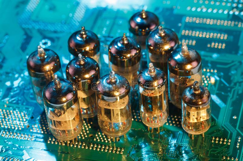 Electronic vacuum tube on circuit board. Electronic vacuum tube on printed circuit board stock images