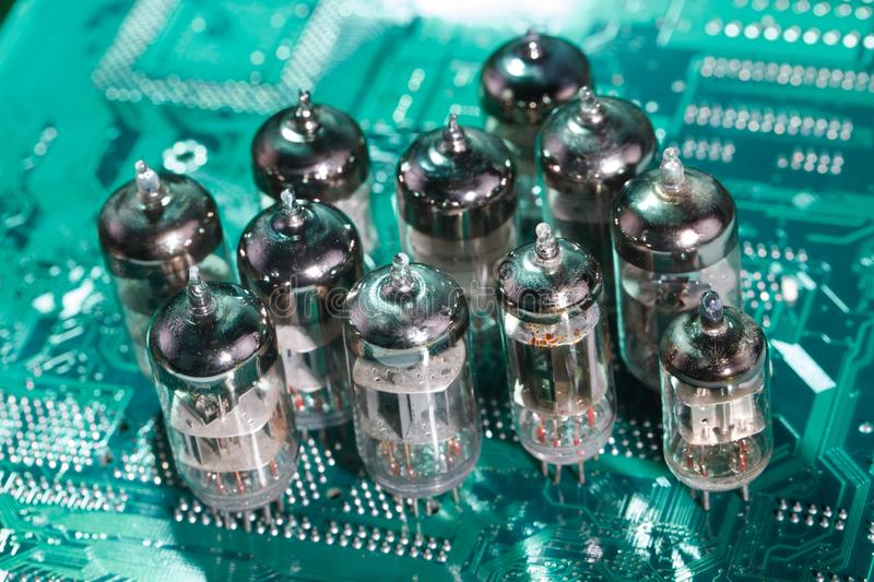 Electronic vacuum tube on circuit board. Electronic vacuum tube on printed circuit board stock photos