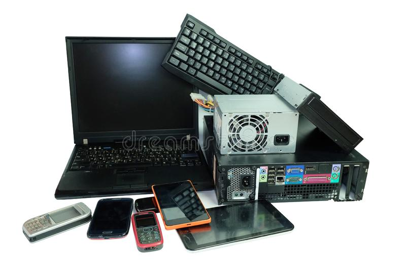 Electronic waste, gadgets electronic equipment for daily use, Laptop and Desktop computer and cell phones isolated on white. Background royalty free stock photo