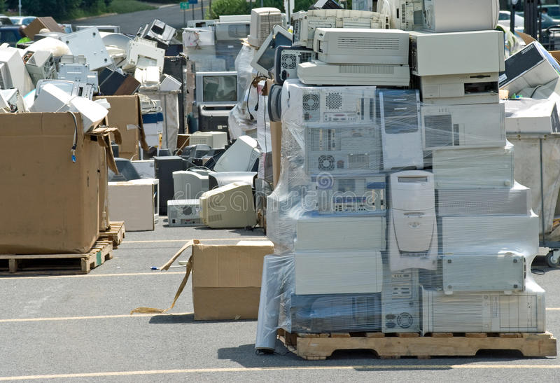 Electronic Waste Recycling. Old CPUs, monitors and printers loaded up on pallets at an electronics recycling event