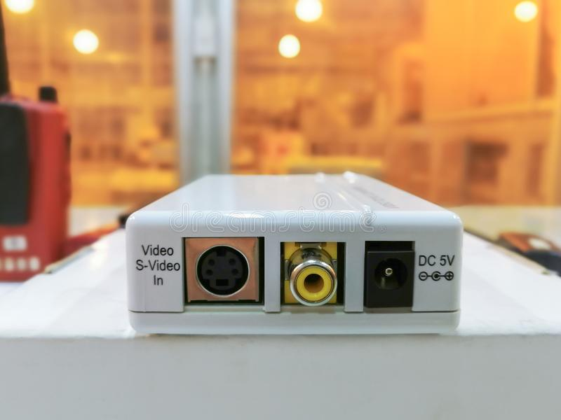 Electronic white box converter video to PC, Media converter module used in industry background. Fiber optic computer network center cable closeup light object stock photos