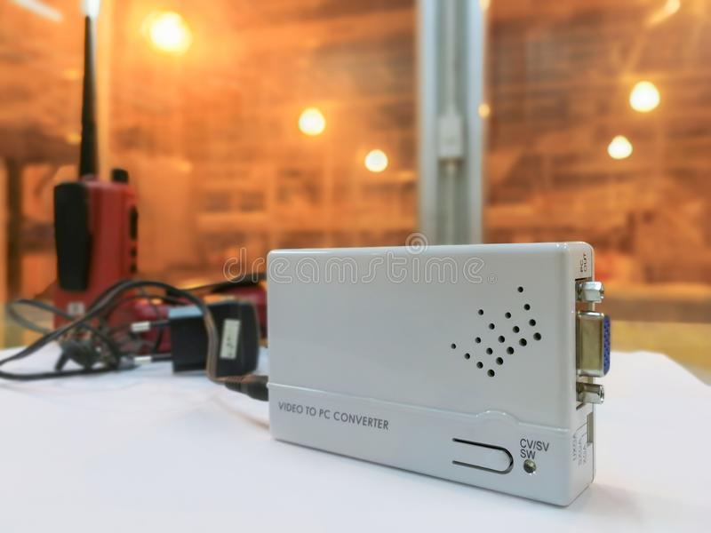 Electronic white box converter video to PC, Media converter module used in industry background. Fiber optic computer network center cable closeup light object stock photo