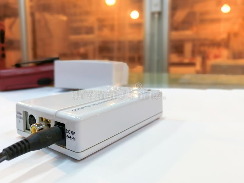 Electronic white box converter video to PC, Media converter module used in industry background. Fiber optic computer network center cable closeup light object royalty free stock photos