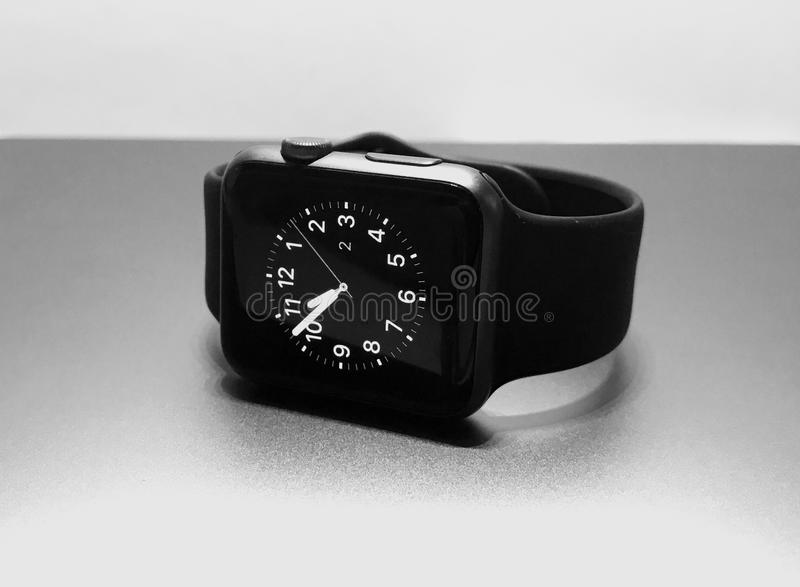 Electronic wrist watch placed on a table stock photos