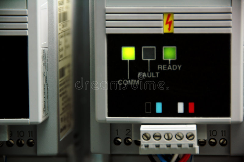 Electronics. An electrical circuit shows comm, fault, ready. Normally used in a production line stock photos