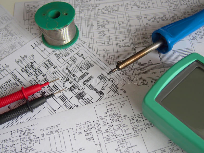 Electronics background. Electronics electrician engineer wiring diagrams and tools background royalty free stock images