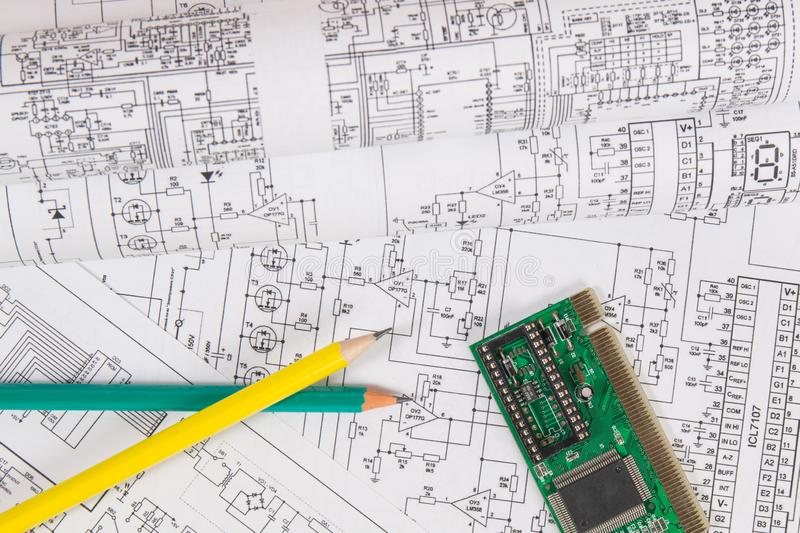Printed drawings of electrical circuits, electronic board and pencils. Science, technology and. Electronics and Engineering. Printed drawings of electrical stock photography