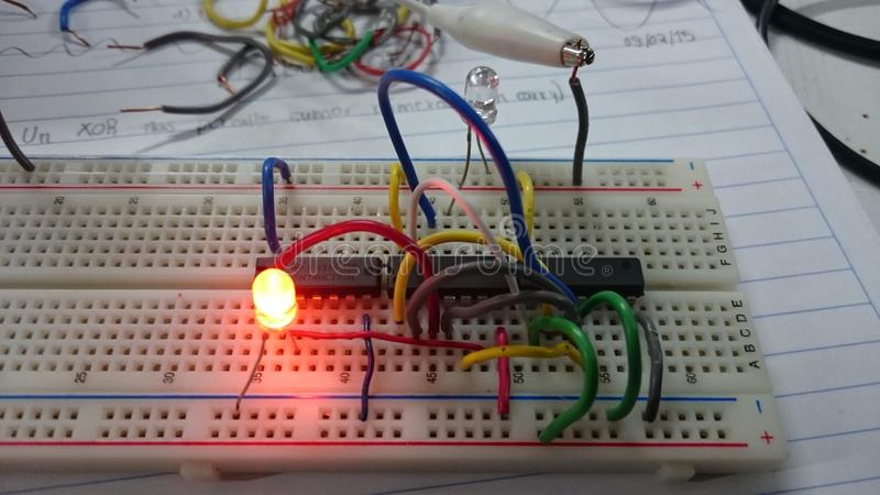 Leds with Boolean logic. Electronics over protoboard stock photography