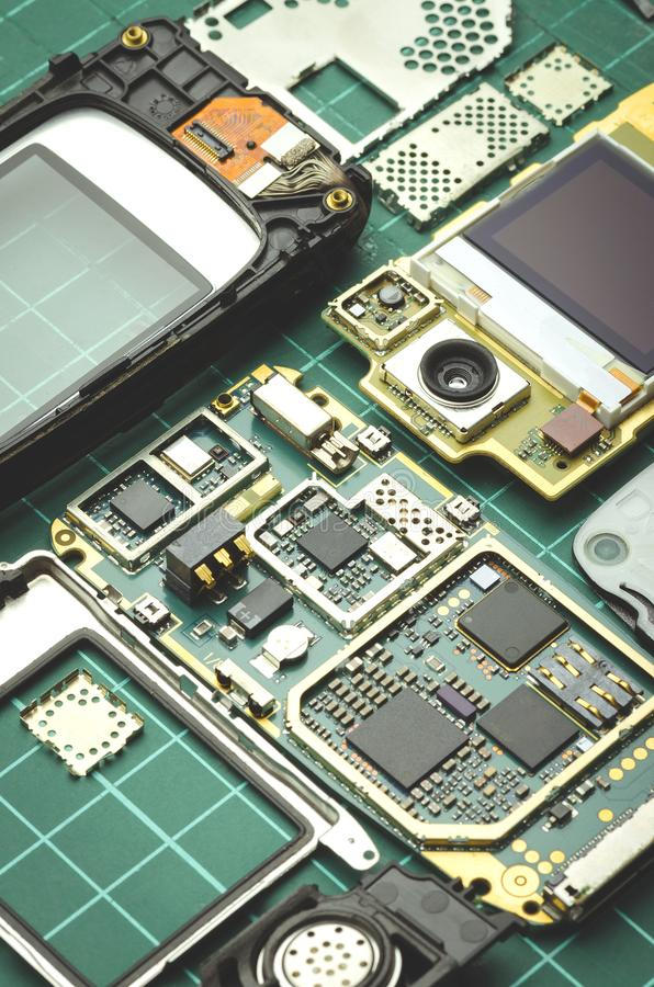 Electronics parts on a green background close-up stock image