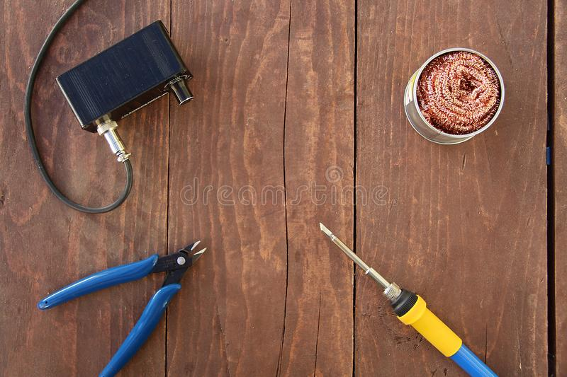 Electronics repair tool on wooden table brown top view royalty free stock photo