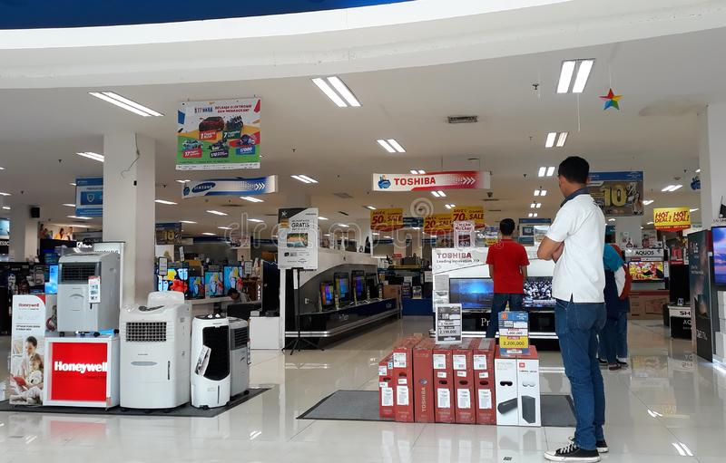 Electronics Store in Depok. Depok, Indonesia - January 1, 2019: Visitors see electronic items in the store in Margo City Mall royalty free stock image