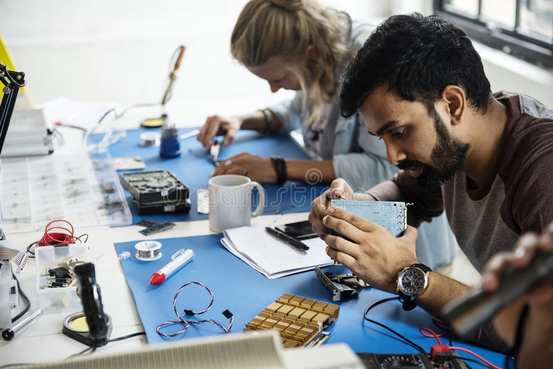 Electronics technicians team working on computer parts stock image