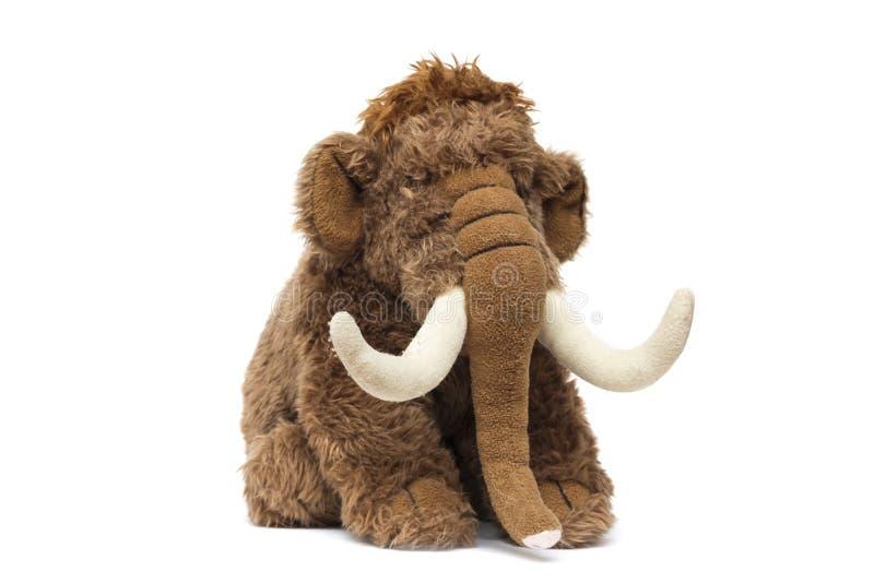 Elefante marrom bonito do brinquedo macio no fundo branco fotos de stock royalty free