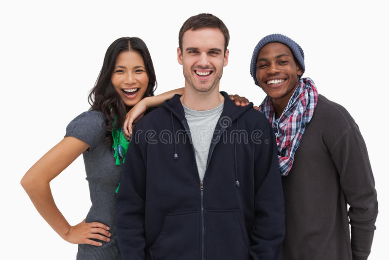 Eleganccy młodzi przyjaciele ono uśmiecha się przy kamerą zdjęcia royalty free