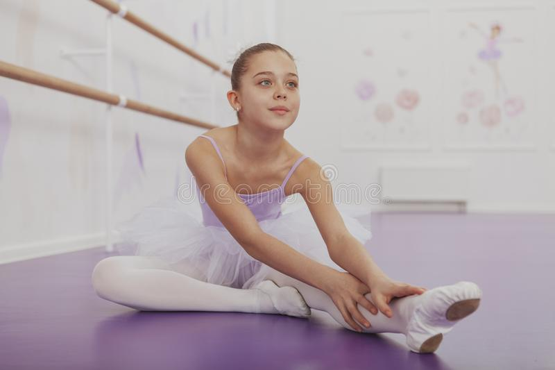 Gorgeous young girl ballerina practicing at dance studio stock photo