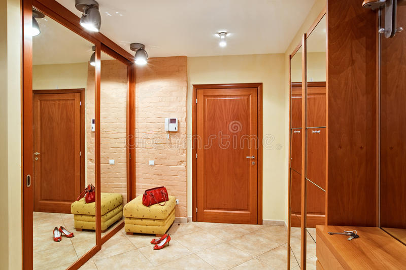 Elegance anteroom interior in warm tones. With hallstand and mirror stock images