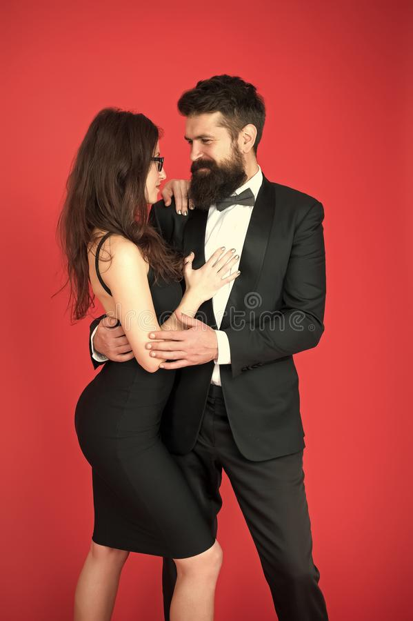 Elegance is not about being noticed. Award ceremony concept. Bearded man wear suit girl elegant dress. Formal dress code royalty free stock image