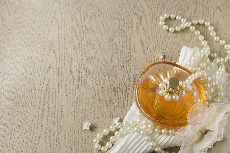 Elegance Perfume Bottle with white pearls stock photos