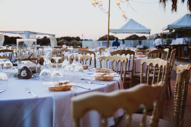 Elegance table set up for wedding in beige. Wedding dinner set up near the sea royalty free stock photos