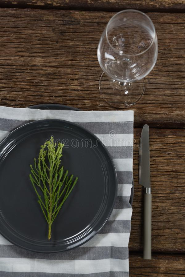 Elegance table setting with empty wine glass on wooden plank. Overhead of elegance table setting with empty wine glass on wooden plank royalty free stock images