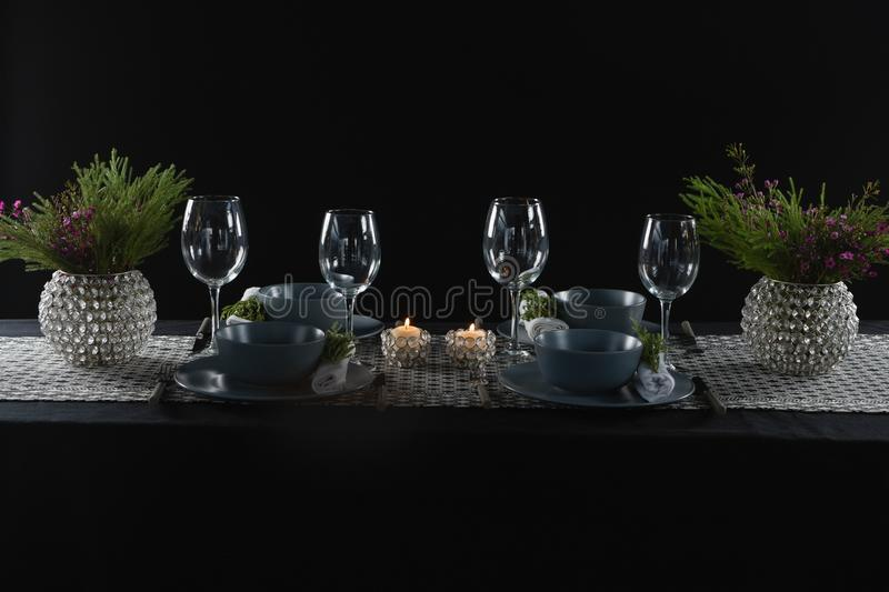 Elegance table setting with empty wine glasses and lit candle. On table stock images