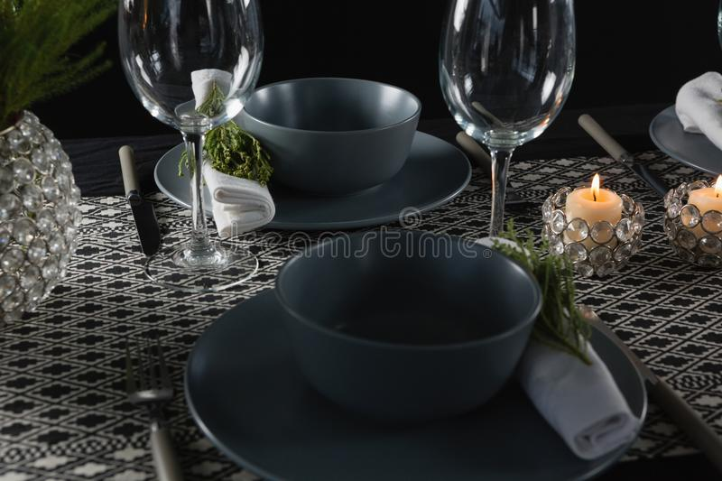 Elegance table setting with empty wine glasses and lit candle. On table royalty free stock images