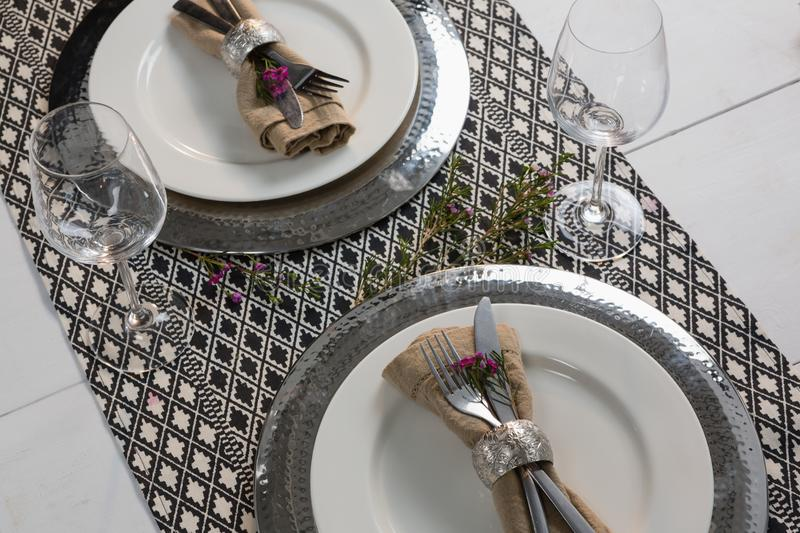 Elegance table setting with wine glasses on placemat. Overhead of elegance table setting with wine glasses on placemat royalty free stock photo
