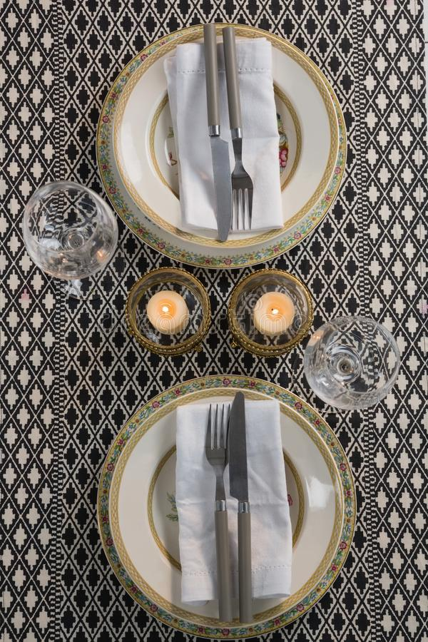 Elegance table setting with wine glasses on placemat. Overhead of elegance table setting with wine glasses on placemat stock photography