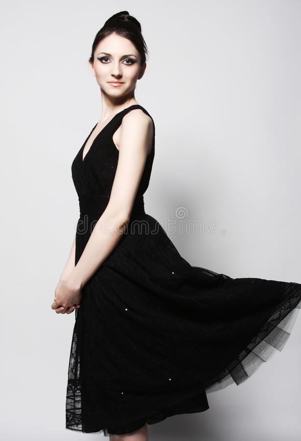 Elegance woman in black dress. Retro style royalty free stock images