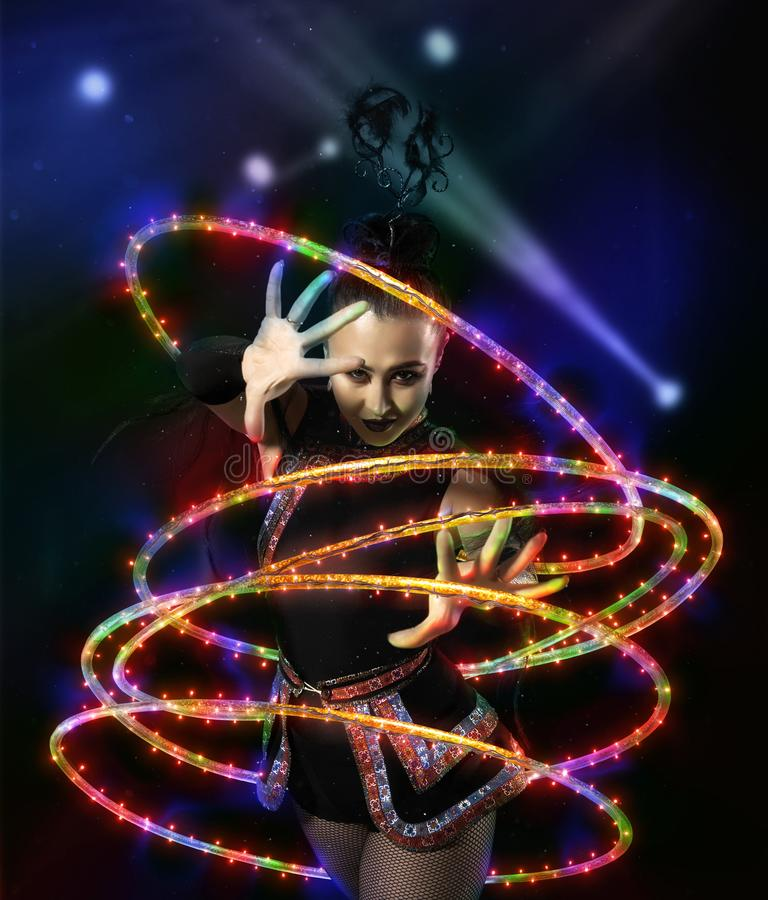 Woman juggler carries out show with hoops. Elegance woman juggler carries out show with hoops royalty free stock photo