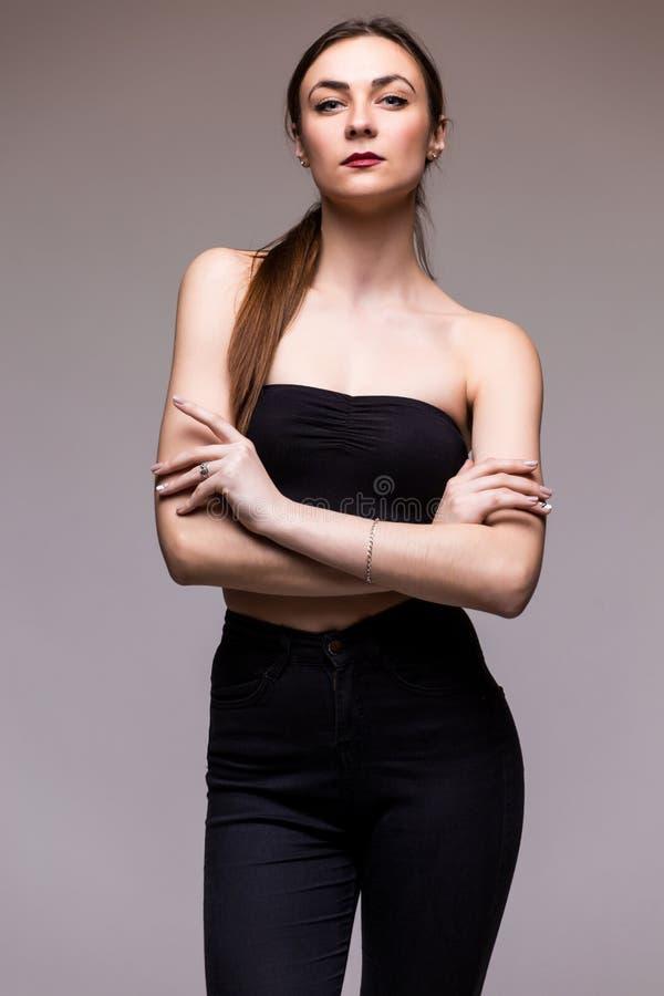 Elegancka modna dziewczyna w czerni ubraniach zdjęcia royalty free