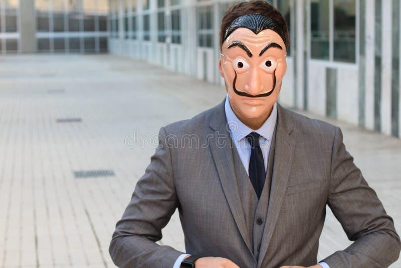 Elegancki biznesmen z maską obrazy royalty free