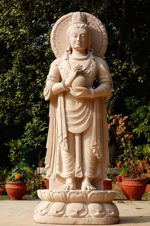 Elegancki Kamienny Buddha z naczyniem obrazy stock