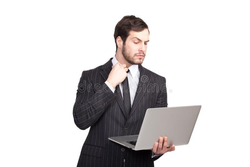 Elegancki mężczyzna z laptopem obraz royalty free