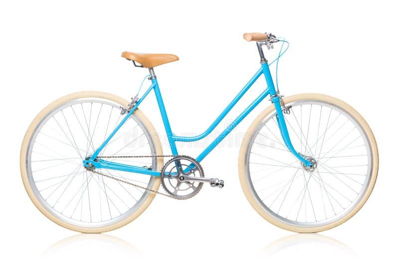 Eleganckich kobiet błękitny bicykl odizolowywający na bielu zdjęcie stock