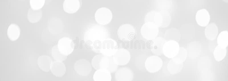 Eleganckiego abstrakta srebra Bożenarodzeniowy tło z białym bokeh li zdjęcia royalty free