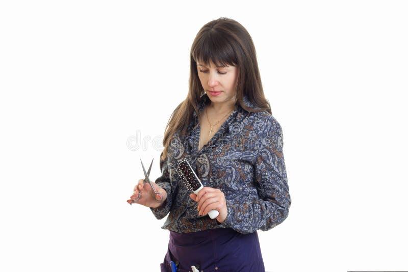 Eleganckiej kobiety stylista z narzędziami w rękach obraz stock