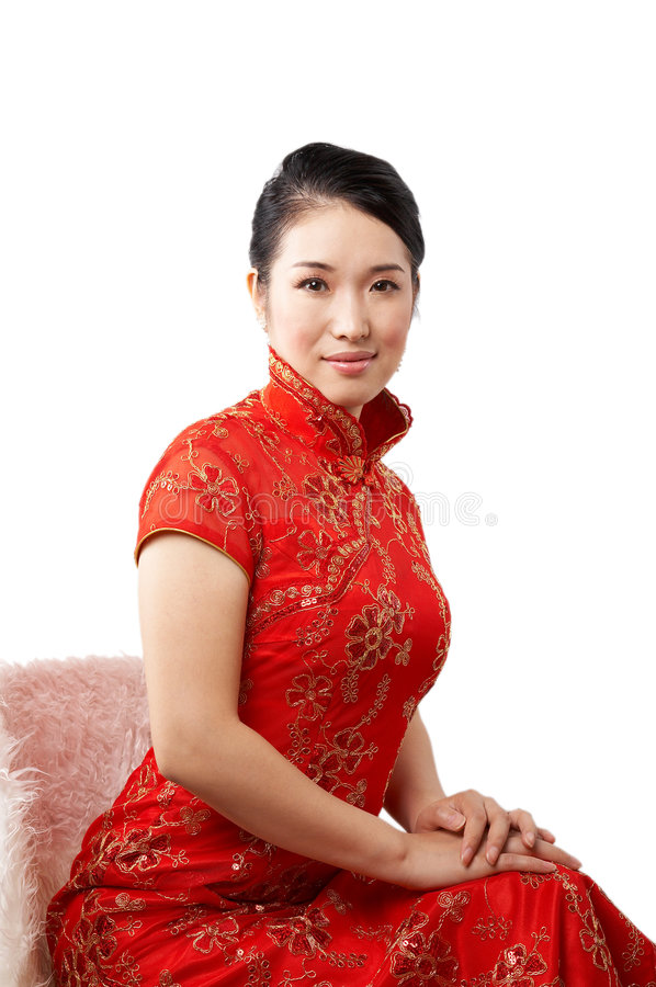 Elegant asian woman. Wearing traditional chinese dress, sitting against white background royalty free stock photo