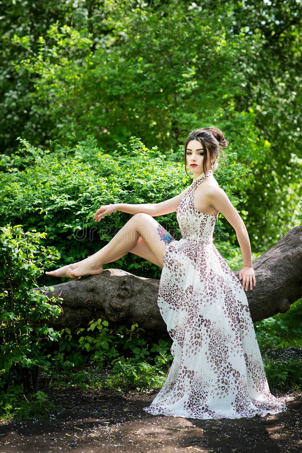 Elegant asian woman in garden, fashion model. With tattoo. Elegant asian woman in garden, fashion model royalty free stock images