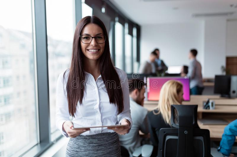 Elegant attractive businesswoman with tablet in office. Elegant attractive businesswoman with digital tablet in office stock photos